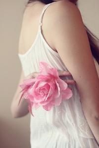 Female Youth Holding Pink Flower by Carolina Hernández
