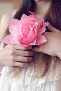 Female Youth Holding Pretend Flower by Carolina Hernández