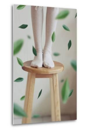 Young Woman Feet in Socks on a Stool