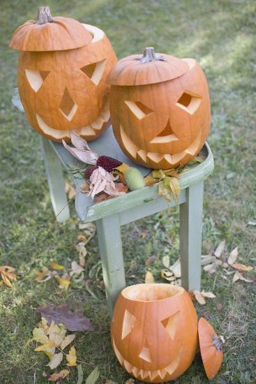 Carved Pumpkin Faces on Garden Table-Foodcollection-Photographic Print