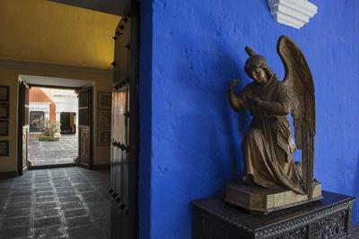 Carved Wooden Angels Guard a Hallway in the Restored 1730 Mansion Casa De Moral-Beth Wald-Photographic Print
