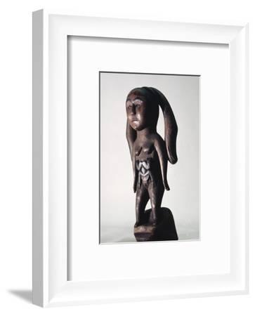 Carved wooden figure of a Sea Mother, possibly Kwakiutl, north-west coast of America-Werner Forman-Framed Photographic Print