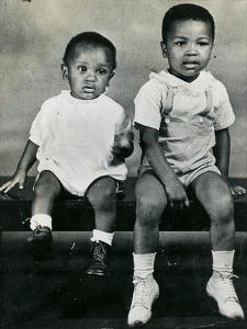Cassius Clay Sitting on a Bench with His Brother Rudy