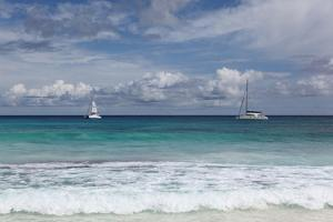 The Seychelles, La Digue, Anse Coco, Two Catamaran Yachtsmen by Catharina Lux