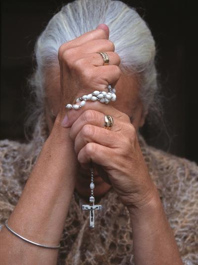 Catholic Woman Prays Holding Her Rosary--Photographic Print