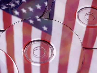 Cds with Reflection of American Flag-Jim Corwin-Photographic Print
