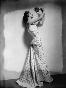 Vogue - April 1948 - Model Gazing in Hand Mirror by Cecil Beaton