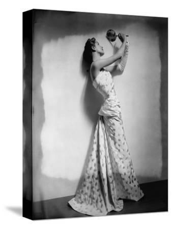 Vogue - April 1948 - Model Gazing in Hand Mirror