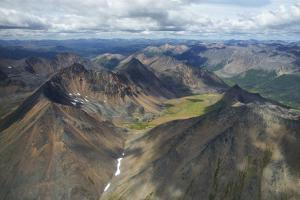 Aerial View of Mineral-Rich Northern Mackenzie Mountains in the Yukon Territory, Canada by Chad Copeland