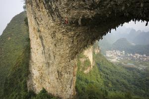 Climber on Natural Arch Formed at Moon Hill, Yangshuo, Guangxi Province, China by Chad Copeland