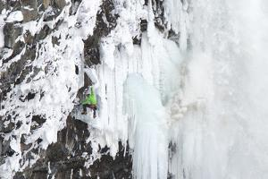 Ice Climber Tooling Ice at Helmcken Falls in British Columbia by Chad Copeland