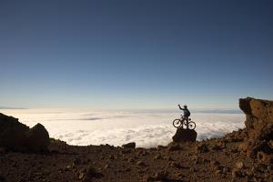 Mountain Biker Above the Clouds in Haleakala National Park by Chad Copeland