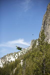 Two Wingsuit Pilots Fly in Close Proximity to a Mountain by Chad Copeland