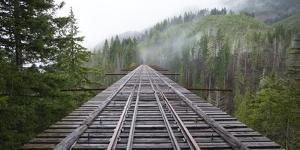 Wooden Train Bridge with Fog by Chad Copeland