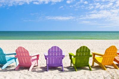 Adirondack Beach Chairs on a Sun Beach in Front of a Holiday Vac by Chad McDermott
