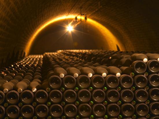 Champagne Bottles in Vaulted Cellar, Champagne Deutz, Ay, Vallee De La Marne, Ardennes, France-Per Karlsson-Photographic Print