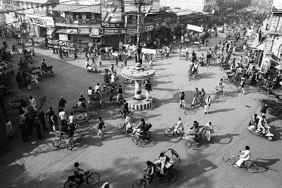Chaos, Cycles and Rickshaws at City Road Intersection, Varanasi, Uttar Pradesh, India, 1982--Photographic Print