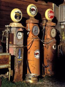 Three Old Gas Pumps