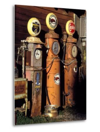 Three Old Gas Pumps