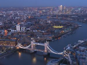 Aerial Photo Showing Tower Bridge, River Thames and Canary Wharf at Dusk, London, England by Charles Bowman