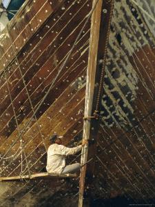 Boatbuilder, Sunda Kelapa (Old Port), Jakarta (Djakarta), Java, Indonesia by Charles Bowman
