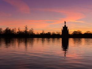Bushey Park Lake At Sunset by Charles Bowman