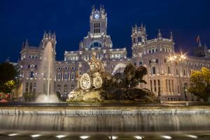 Fountain and Plaza De Cibeles Palace (Palacio De Comunicaciones) at Dusk, Plaza De Cibeles, Madrid by Charles Bowman
