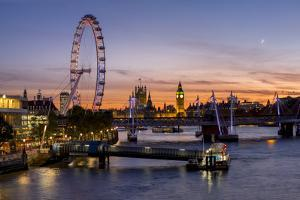 Millenium Wheel (London Eye) with Big Ben on the skyline beyond at sunset, London, England, United  by Charles Bowman