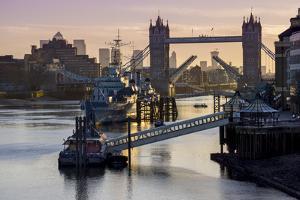 Tower Bridge raising deck with HMS Belfast on the River Thames, London, England, United Kingdom, Eu by Charles Bowman