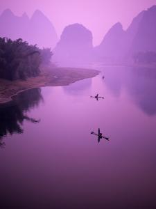 Fisherman on Raft in Li River, Yangshou, Guanxi, China by Charles Crust