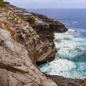 Multiple Exposure Stop Action Photo of Jump Off Cliff at Kawaihoa Point by Charles Crust