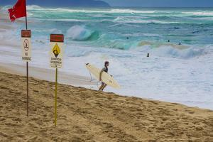 Surfers at Sunset Beach, Oahu, Hawaii, USA by Charles Crust