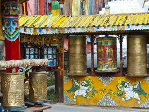 Tibetan Buddhist Prayer Wheels at Shuzheng Village, Sichuan Province, China by Charles Crust