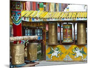 Tibetan Buddhist Prayer Wheels at Shuzheng Village, Sichuan Province, China by Charles Crust
