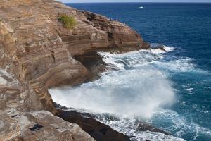 USA, Hawaii, Oahu, Honolulu. Water Shoots from Spitting Cave at Kawaihoa Point by Charles Crust