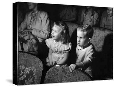 Children Watching Cartoons in a Movie Theater