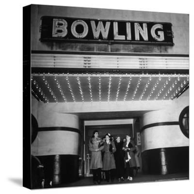 Members of a Women's Bowling League Exiting the Bowling Alley