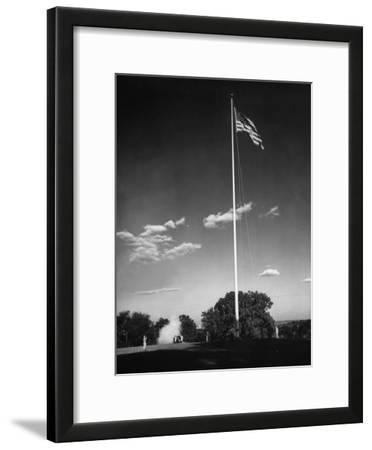 Soldiers Lowering American Flag