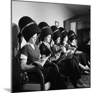 Women Aviation Workers under Hair Dryers in Beauty Salon, North American Aviation's Woodworth Plant by Charles E. Steinheimer