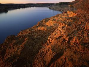 Sandstone bluff at sunset along Kanopolis Lake, Kanopolis State Park, Kansas, USA by Charles Gurche