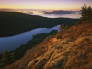 Sunrise from Mt. Constitution, Moran State Park, Orcas Island, Washington, USA by Charles Gurche