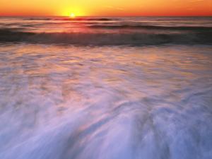 Sunrise over Atlantic Ocean, Assateague Island National Seashore, Virginia, USA by Charles Gurche