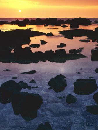 Sunset, Big Island of Hawaii, Kona Coast, Hawaii, USA by Charles Gurche
