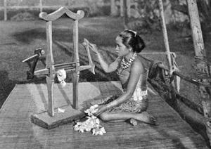 Iban Woman Making Thread with a Mangle, Borneo, 1922 by Charles Hose
