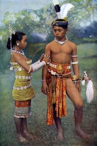 Young Iban or Sea Dayaks People in Gala Attire, Borneo, 1922 by Charles Hose