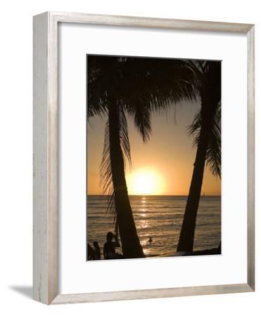 Sun Sets in Pacific Ocean at Waikiki Beach, Honolulu, Hawaii
