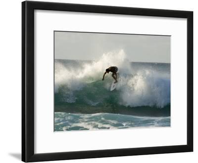 Surfer in the Pacific Ocean on the North Shore of Oahu, Hawaii