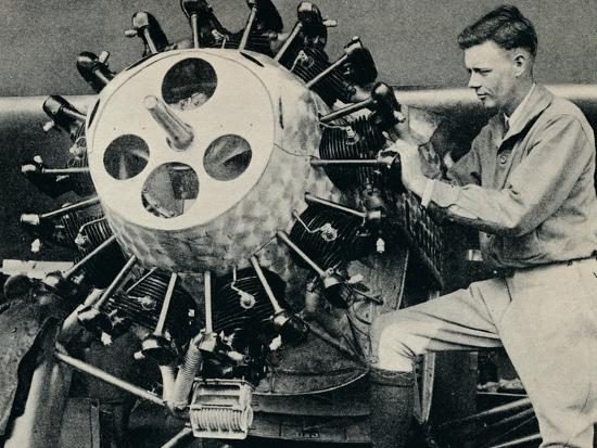 Charles Lindbergh checking the engine of his aircraft before his transatlantic flight, 1927-Unknown-Photographic Print