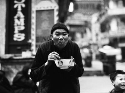 Chinese Man Using Chopsticks To Eat From Bowl, Portrait, Hong Kong