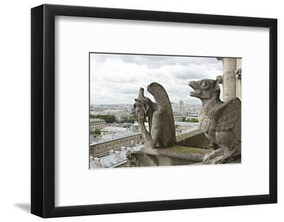 Europe, France, Paris. Two Gargoyles on the Notre Dame Cathedral